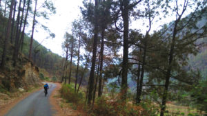 Dippy riding his Gary Fisher bicycle down the Varuna River Valley in Uttarkashi